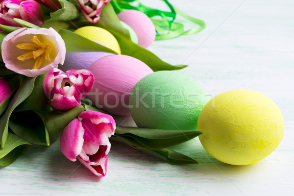 Easter arrangement with pink, green, yellow eggs Stock photo © TasiPas