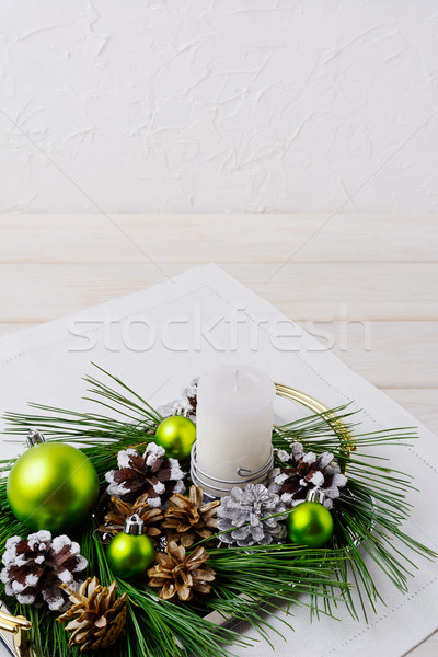 Christmas background with snowy pinecone and green ornaments  Stock photo © TasiPas