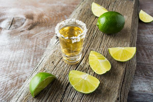 Tequila lövés citrus szeletek rusztikus fából készült Stock fotó © TasiPas
