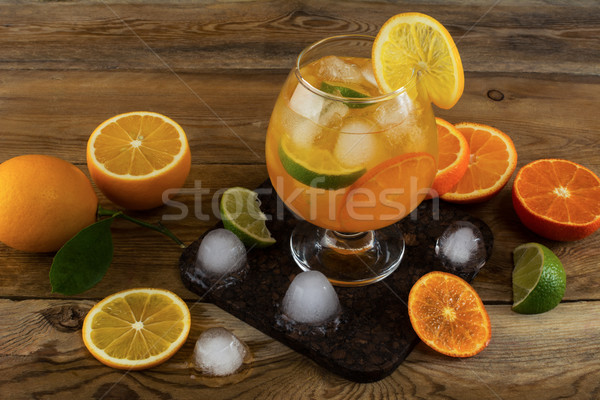 Fresh citrus drink on wooden background Stock photo © TasiPas