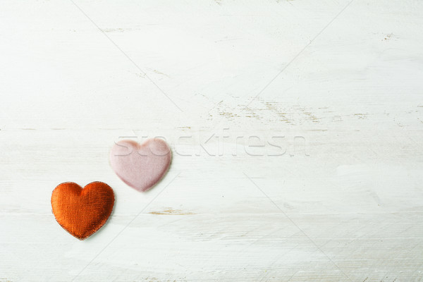 Two silk hearts on a white wooden background Stock photo © TasiPas