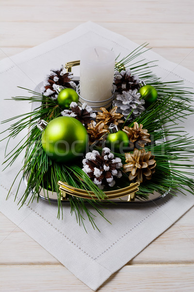 Christmas centerpiece with snowy pine cones on the serving tray Stock photo © TasiPas