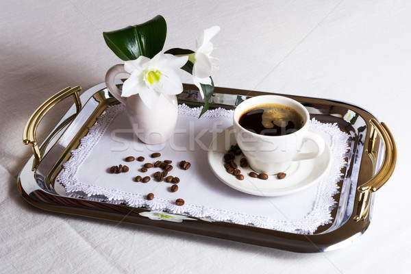 Cup of coffee on exquisite embroidered napkin Stock photo © TasiPas
