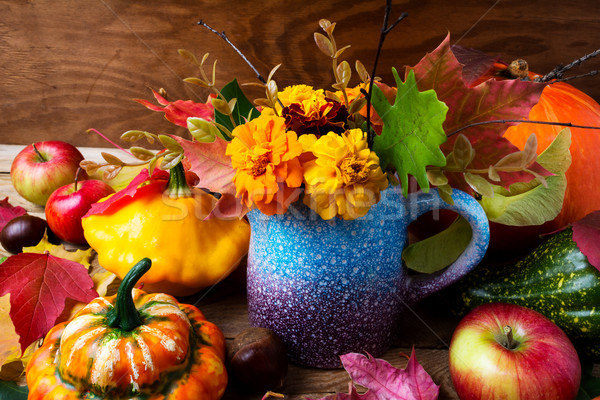 Thanksgiving background with marigold flowers, pumpkins and appl Stock photo © TasiPas