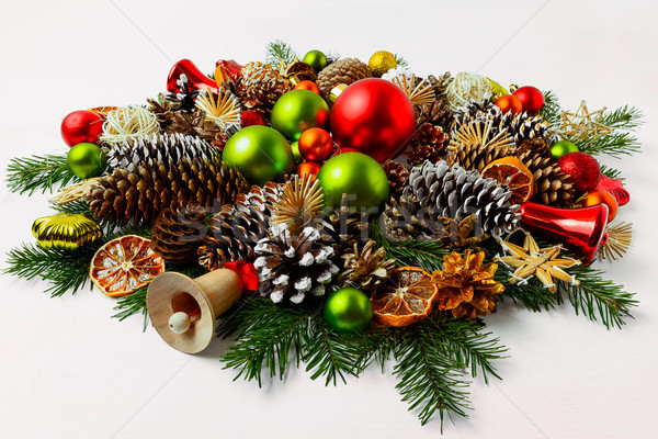 Christmas wreath with wooden jingle bell, copy space. Stock photo © TasiPas