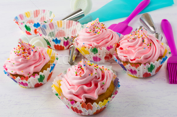 Pink cupcakes  and cookware Stock photo © TasiPas