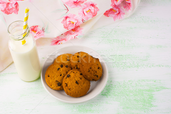 Milk bottle with straw and cookies  Stock photo © TasiPas