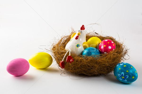 Porcelain Hen and Easter eggs  Stock photo © TasiPas