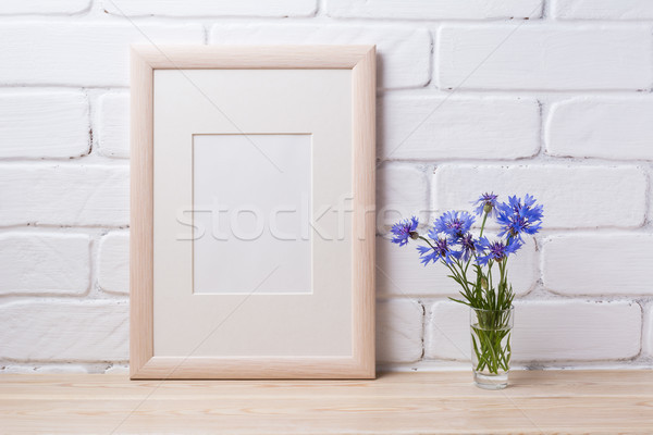 Wooden frame mockup with cornflower Stock photo © TasiPas