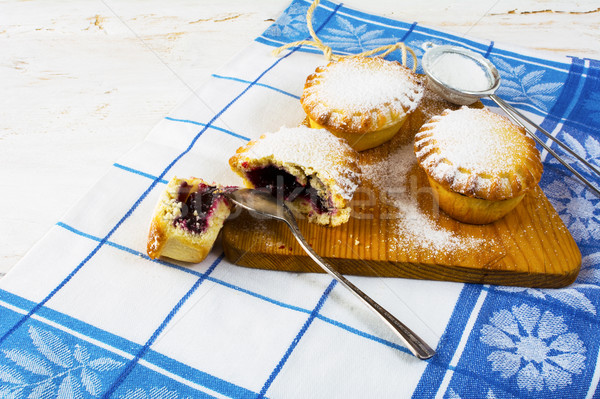 Stock photo: Small sweet pie on the cutting board