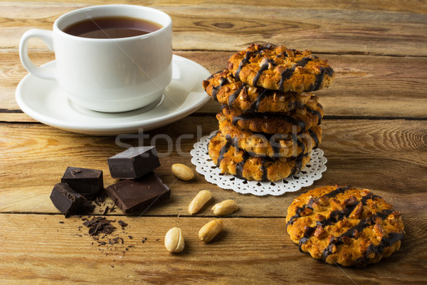 Chocolate icing cookies and cup of tea Stock photo © TasiPas