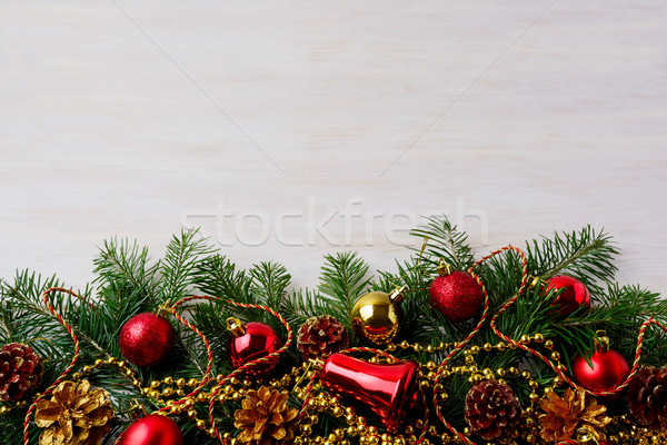 Christmas background with pinecone, golden and red ornaments  Stock photo © TasiPas