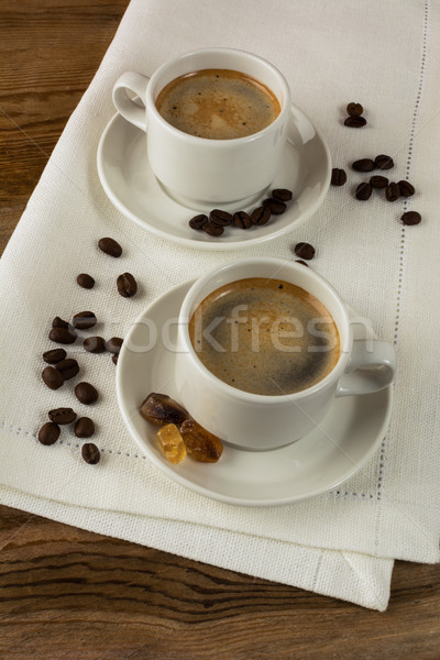Coffee break on white linen napkin Stock photo © TasiPas