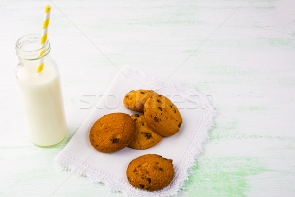Milk bottle with straw and homemade cookies  Stock photo © TasiPas