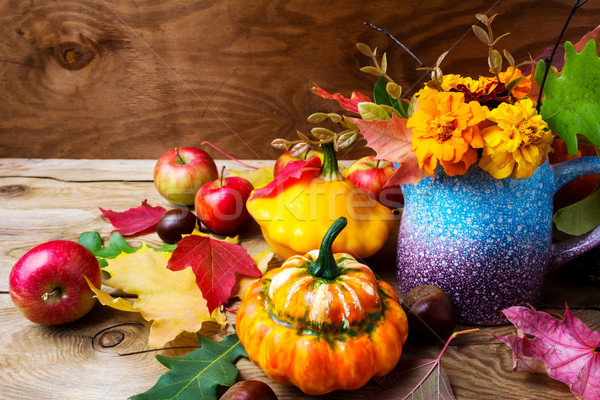 Rustic Thanksgiving table centerpiece with tagetes flowers Stock photo © TasiPas