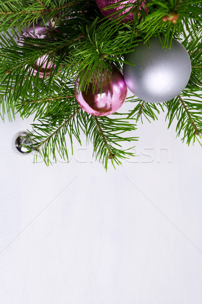 Christmas arrangement with pink and silver baubles, copy space Stock photo © TasiPas