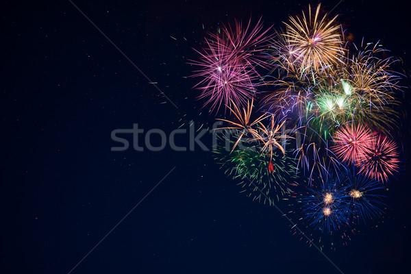 Stock photo: Beautiful celebration sparkling fireworks over starry sky, copy