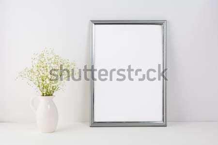 Frame mockup with white tender flowers Stock photo © TasiPas