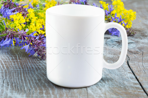 White coffee mug mockup with lilac and yellow flowers Stock photo © TasiPas