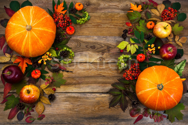 Thanksgiving greeting with leaves and pumpkin on wooden table Stock photo © TasiPas