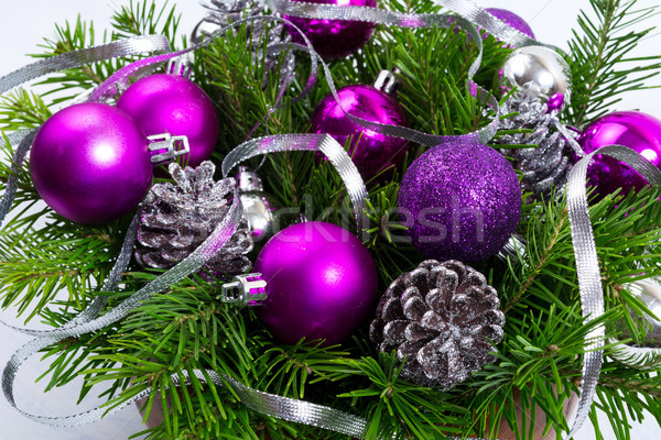 Christmas greenery with silver glitter cones and purple ornament Stock photo © TasiPas
