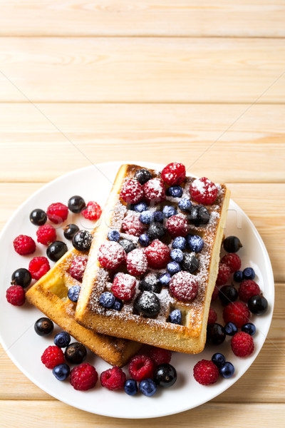 Soft Belgian waffles with blueberry, raspberry, blackcurrant and Stock photo © TasiPas
