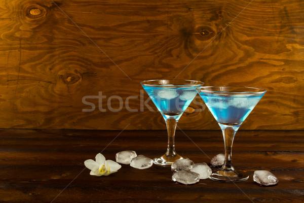 Kék likőr koktél martini szemüveg víz Stock fotó © TasiPas