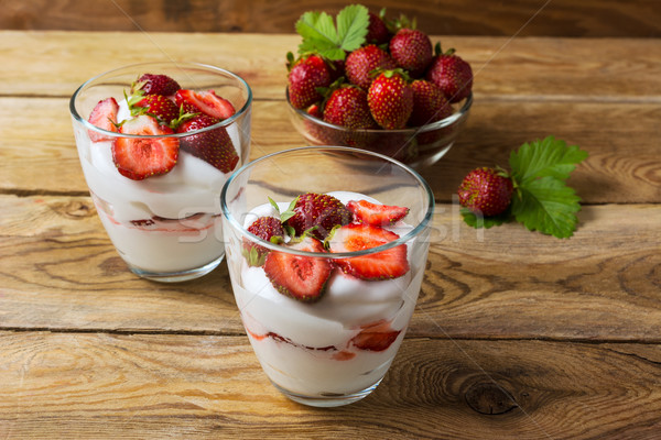 Layered dessert with cream, strawberry and ripe berries  Stock photo © TasiPas