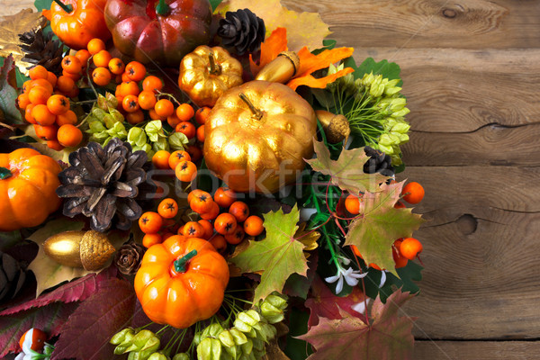 Thanksgiving wreath with pumpkins and leaves copy space Stock photo © TasiPas
