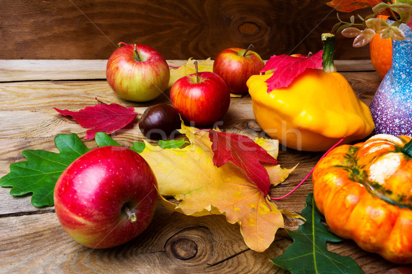 Ripe apples and yellow gourd with  leaves, close up.  Stock photo © TasiPas