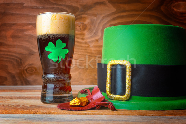 St.Patrick concept with green leprechaun hat, beer and gold  Stock photo © TasiPas