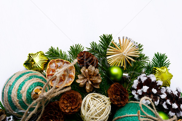Christmas tree branches with handmade ornaments and pine cones  Stock photo © TasiPas