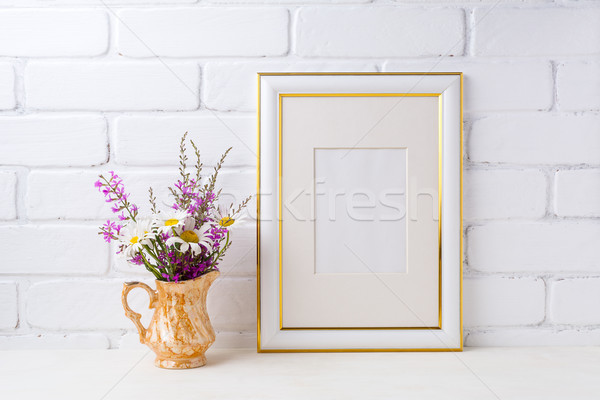Gold decorated frame mockup with chamomile and purple flowers in Stock photo © TasiPas