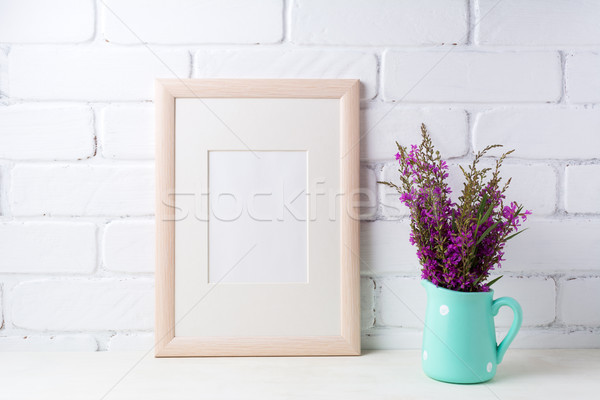 Wooden frame mockup with maroon purple flowers in mint pitcher Stock photo © TasiPas
