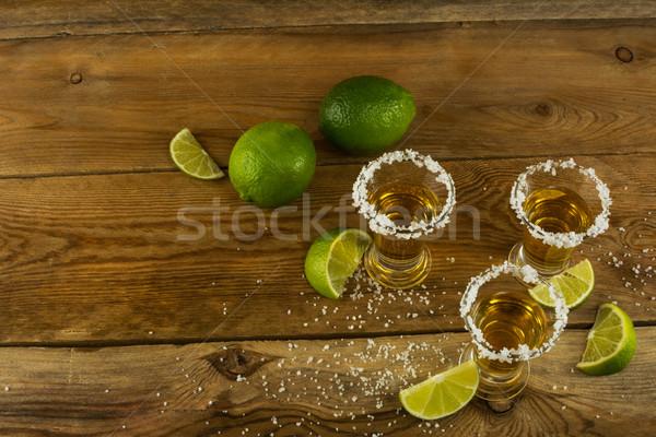 Arany mexikói tequila citrus só lövés Stock fotó © TasiPas
