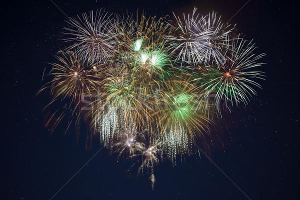 Pezsgő arany zöld ünneplés tűzijáték csillagos ég Stock fotó © TasiPas