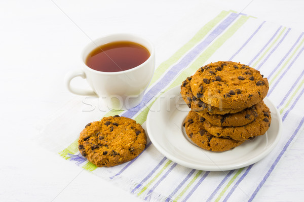 Tea time with chocolate chip cookies Stock photo © TasiPas