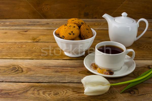 Cup of tea and porcelain teapot Stock photo © TasiPas
