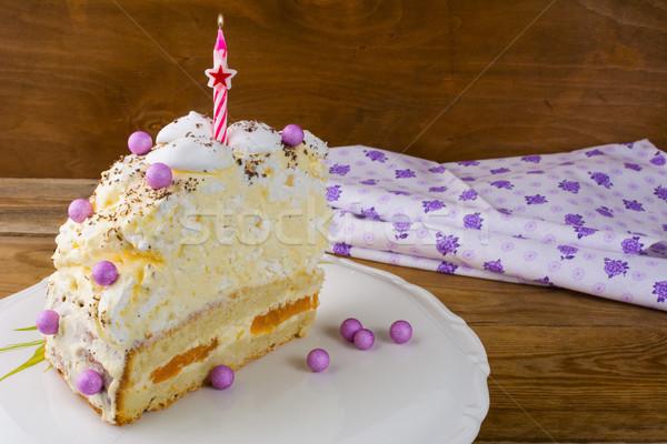 Slice of meringue birthday cake with apricot Stock photo © TasiPas