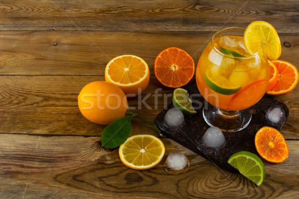 Fresh citrus cocktail on wooden table Stock photo © TasiPas