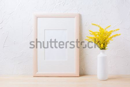 Wooden frame mockup with ornamental grass in exquisite vase Stock photo © TasiPas
