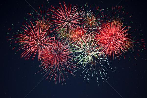 Pezsgő piros zöld citromsárga tűzijáték csillagos ég Stock fotó © TasiPas
