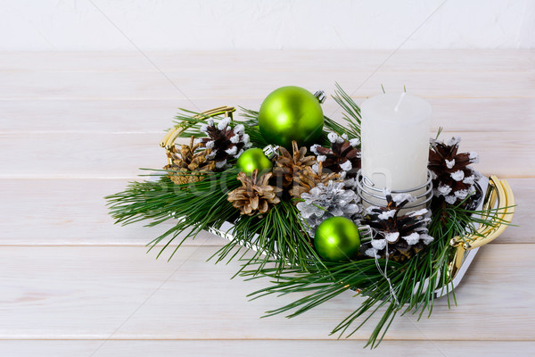 Christmas green ornaments, snowy and silver pinecones  Stock photo © TasiPas