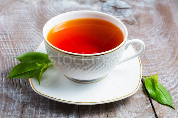 カップ 茶 緑の葉 素朴な 木製のテーブル 朝食 ストックフォト © TasiPas