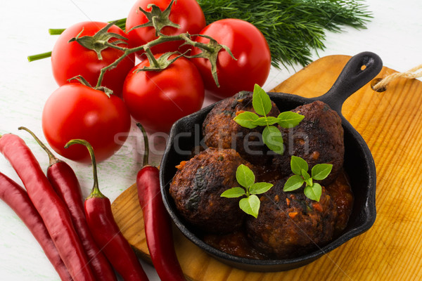 Grilled meatballs served in a skillet Stock photo © TasiPas