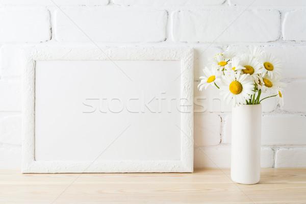 White landscape frame mockup with daisy flower in styled vase  Stock photo © TasiPas
