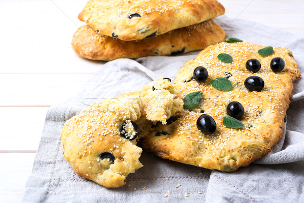 Focaccia with olive, garlic and herbs Stock photo © TasiPas