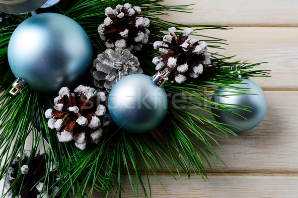 Christmas background with blue ornaments and decorated pine cone Stock photo © TasiPas