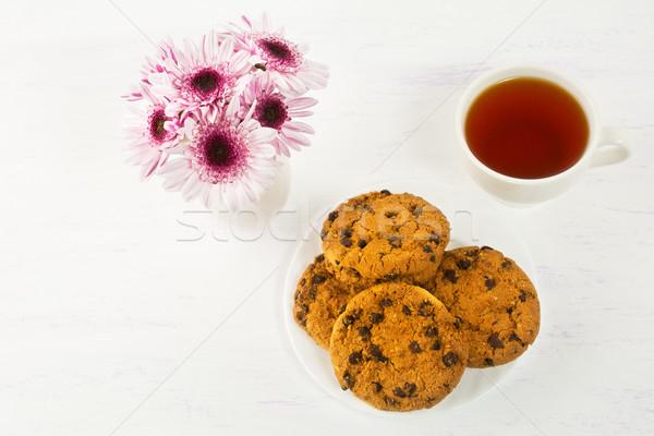 Romantic tea time with chocolate chip cookies Stock photo © TasiPas