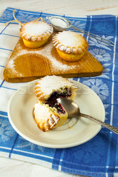 Small confiture pie on the white plate Stock photo © TasiPas